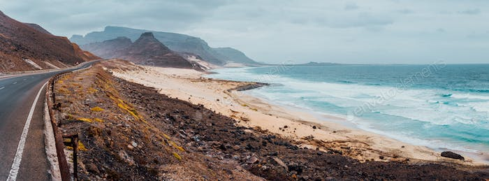 Calhau, Sao Vicente Island Cape Verde. Road along atlantic coastline white sand dunes and ocean