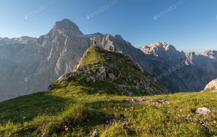 Male hiker in the mountains on a clear summer morning