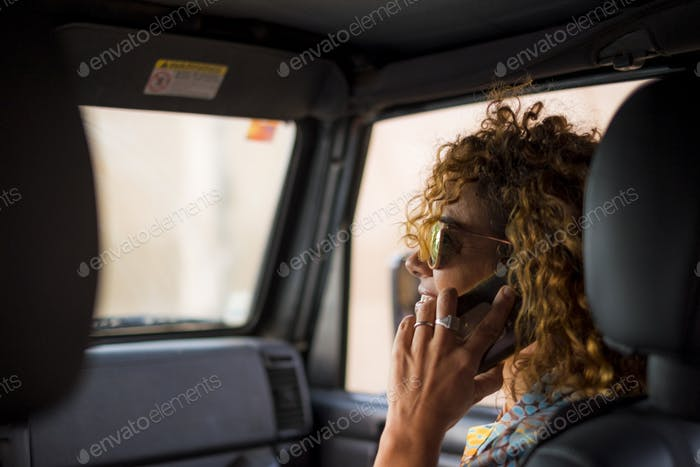 nice beautiful young woman smile and use mobile phone inside the car