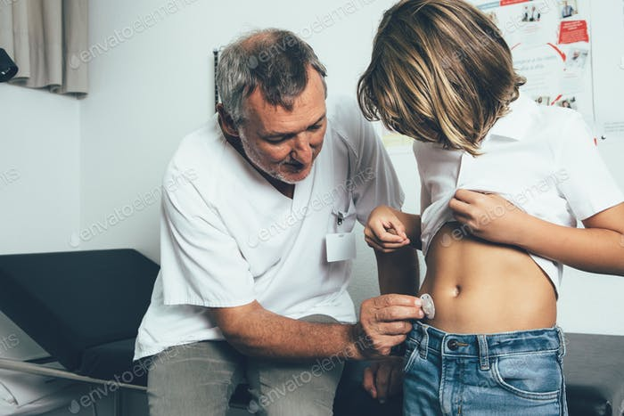 Doctor helping to put an insulin pump