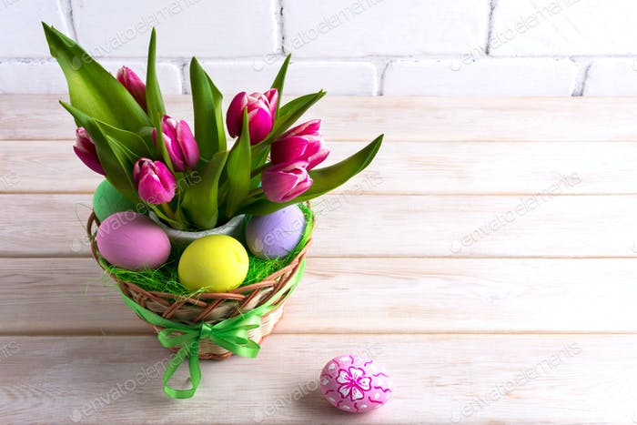 Easter table centerpiece with pastel color hand painted eggs
