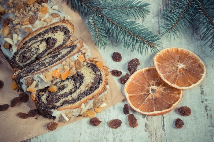 Vintage photo, Homemade poppy seeds cake and spruce branches, dessert for Christmas