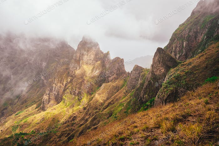 Santo Antao, Cape Verde. Mountain tops covered in fog and lit by the sun light in Xoxo in the