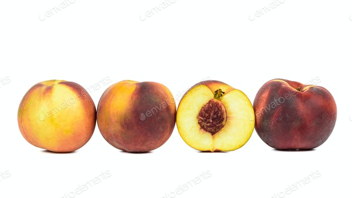 Ripe peaches in a row on white background