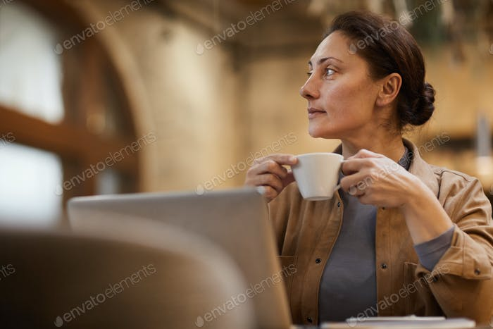 Businesswoman with cup of coffee