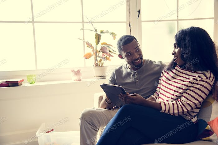 African couple working on tablet