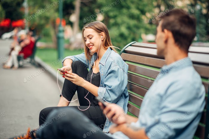 Phone addiction, man and woman ignoring each other