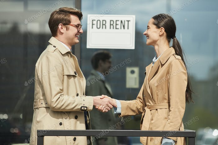 Rental Agent Shaking Hands with Client