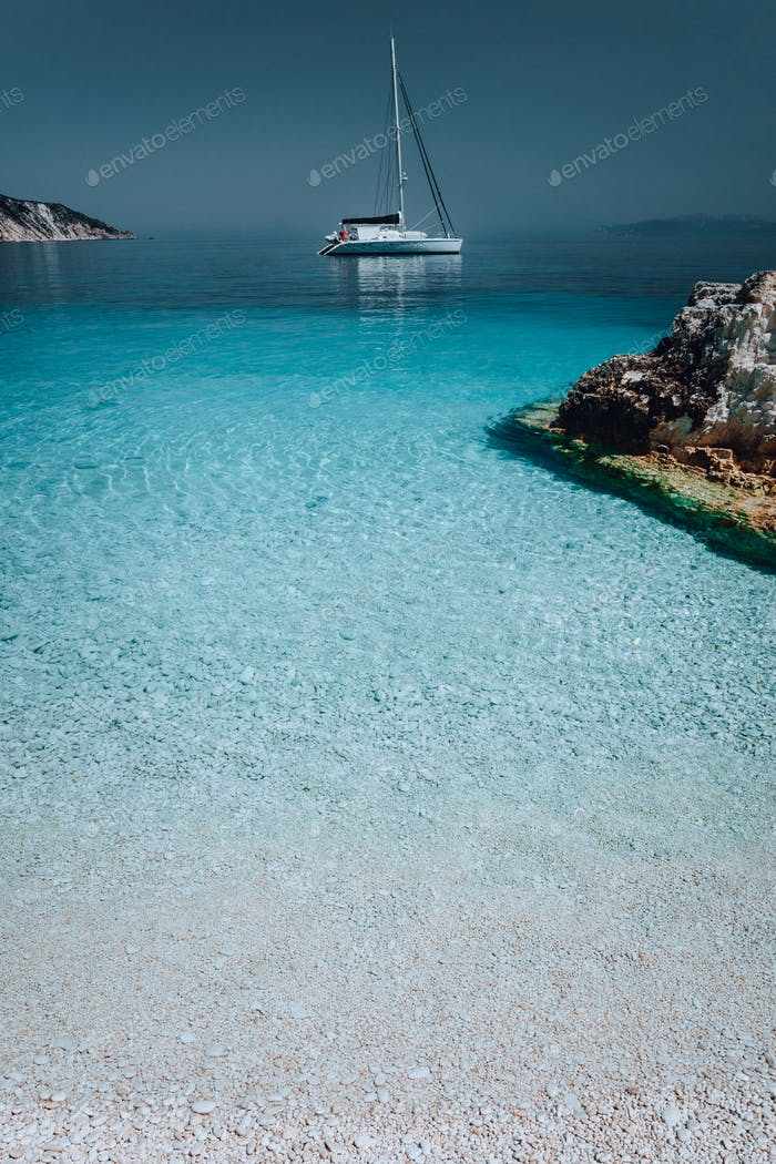 Gorgeous seascape with white yacht on calm water. Summer vacation holiday luxury travel romantic