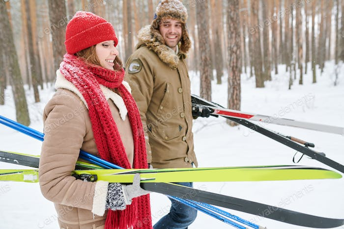 Couple Carrying Skis