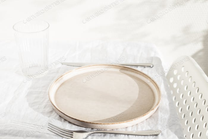 Empty Plate on White Table.