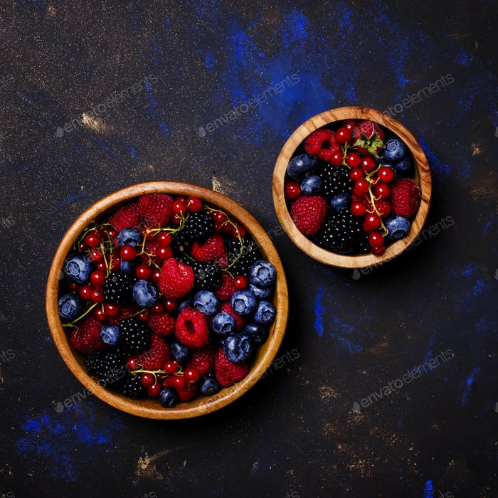 Assortment of berries in wooden bowls