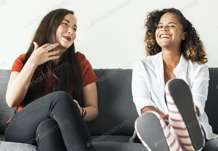 Girls talking together on a couch