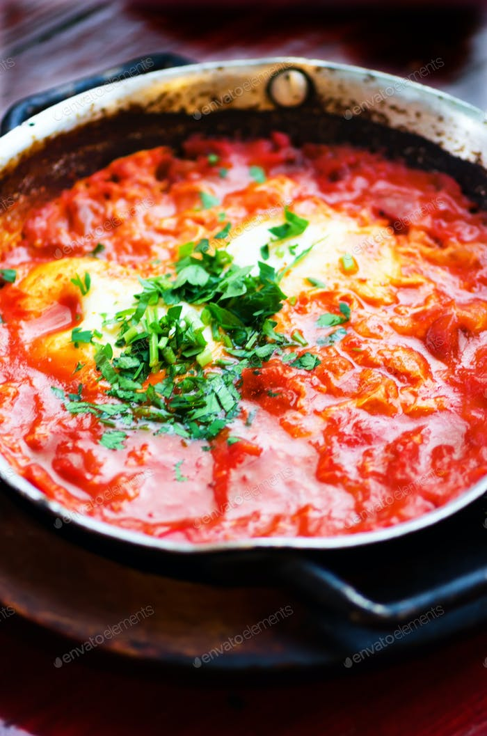 Shakshuka. Traditional jewish food and middle eastern cuisine recipe. Fried eggs, tomatoes, bell