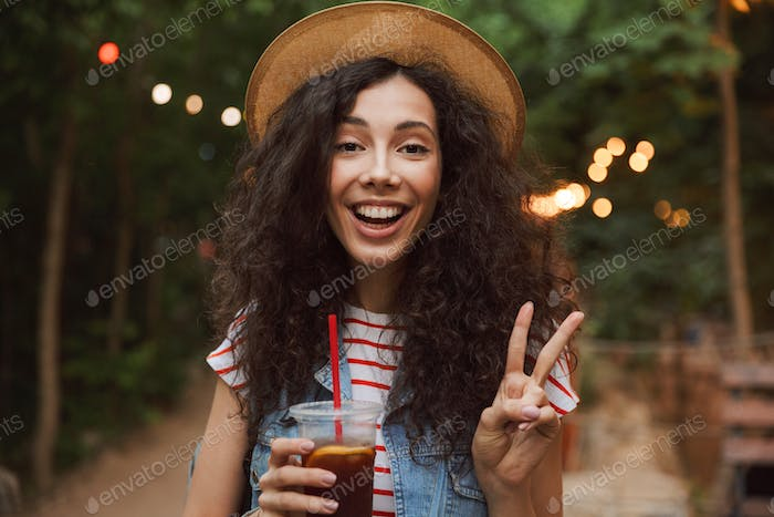 Portrait closeup of brunette beautiful woman 18-20 wearing straw