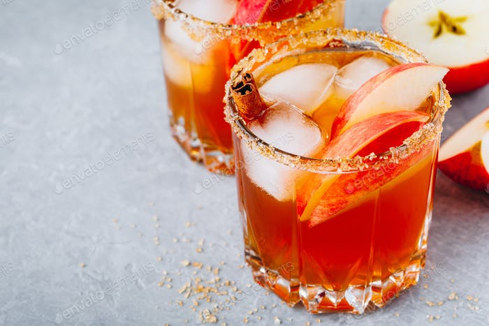 Apple cider margarita with cinnamon and ice for Halloween or Thanksgiving in glass