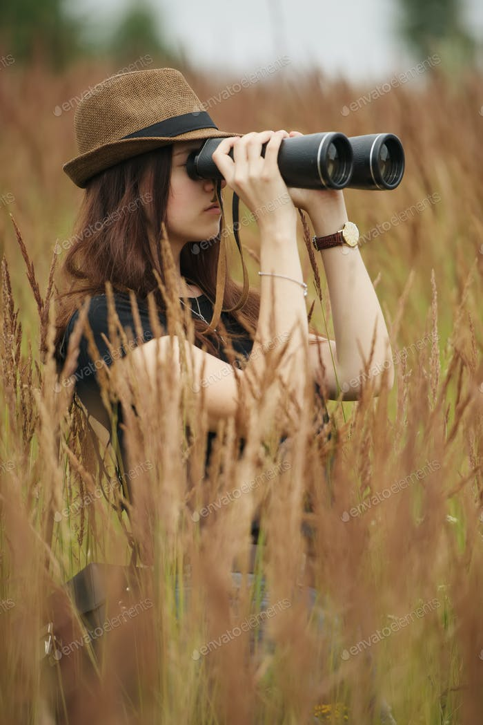 beautiful girl in high grass portrait