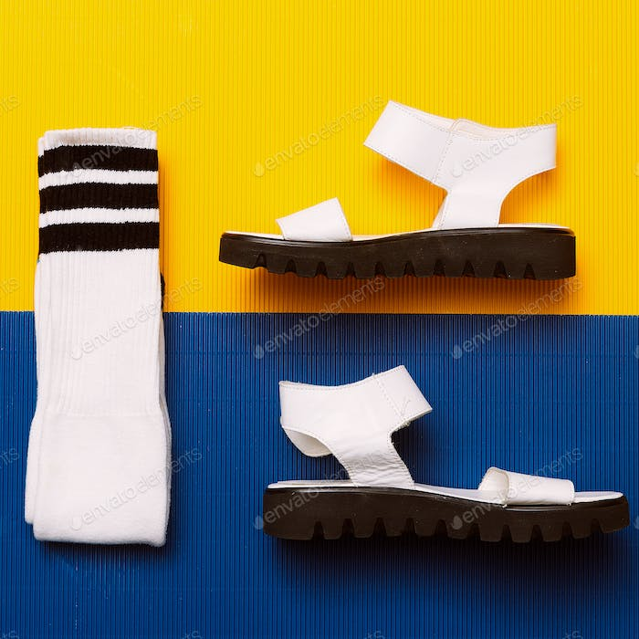 White sandals and socks. Minimal Summer sports style
