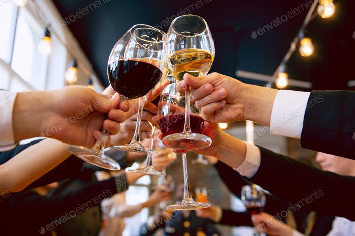 Happy co-workers celebrating while company party and corporate event
