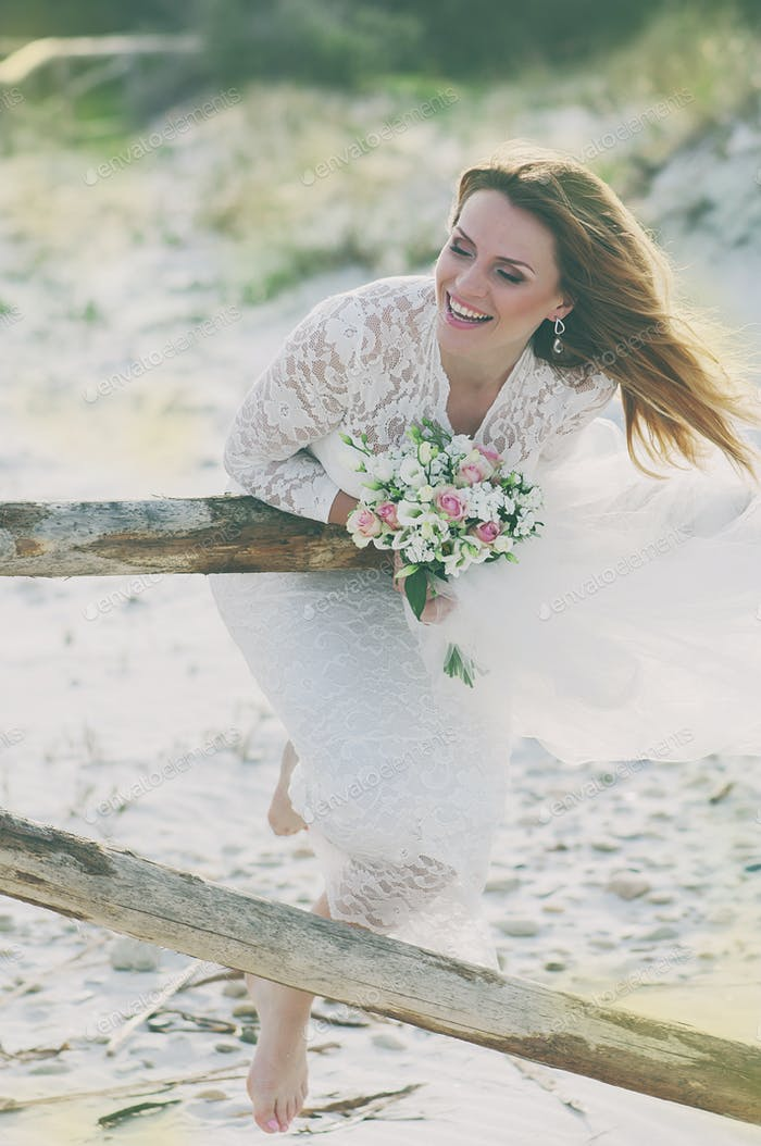 Happy young woman in wedding dress