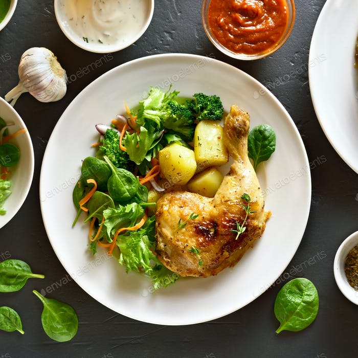 Grilled chicken leg with potato and green salad