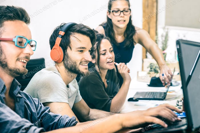 Group of young people employee workers with computer in startup studio