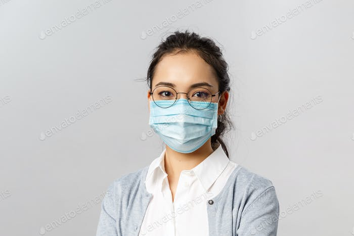 Covid19, virus, health and medicine concept. Portrait of young asian woman wearing medical face mask