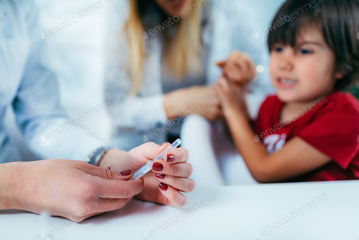 Vaccination - Boy Receives a Vaccine
