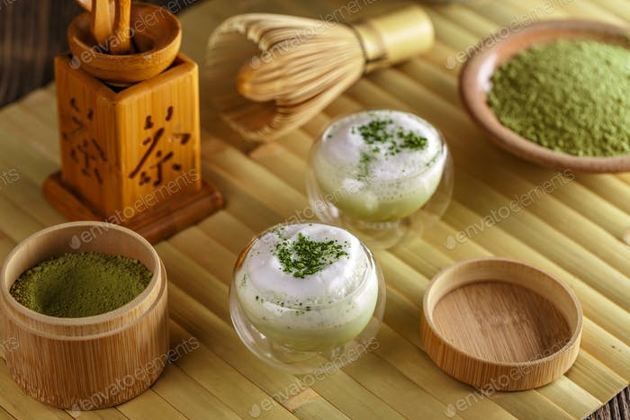 Matcha latte in a glass cup