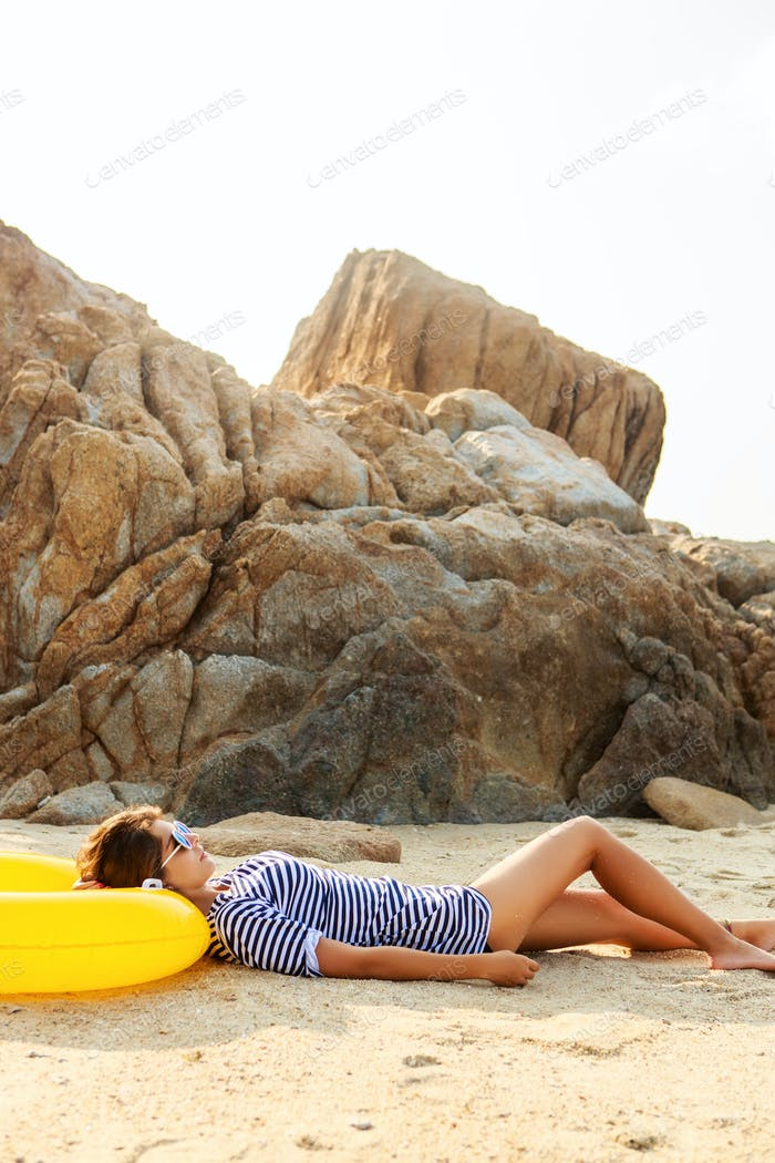 Sexy girl rest on the beach.