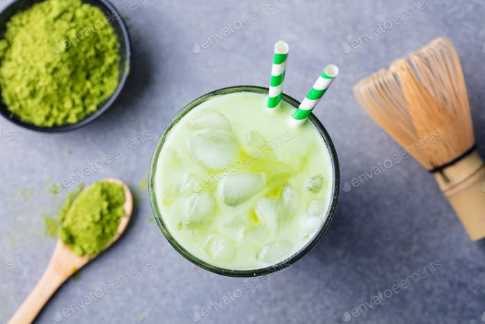 Matcha Green Tea Ice Latte with Matcha Powder and Bamboo Whisk. Top View.