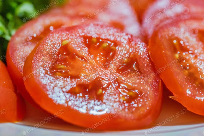 Close up slices of fresh juicy tomato
