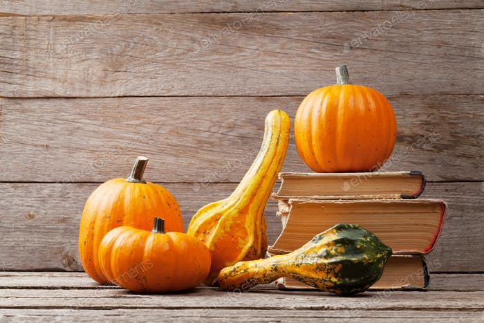 Autumn pumpkins on wooden table