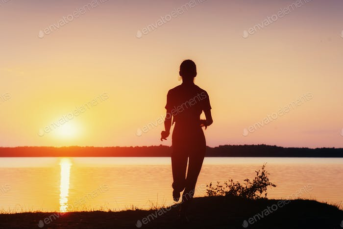 girl at sunset by the lake.