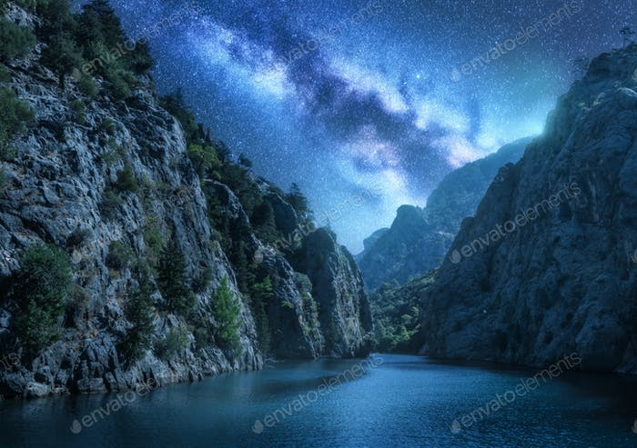 Milky Way over the beautiful mountain canyon and sea at night