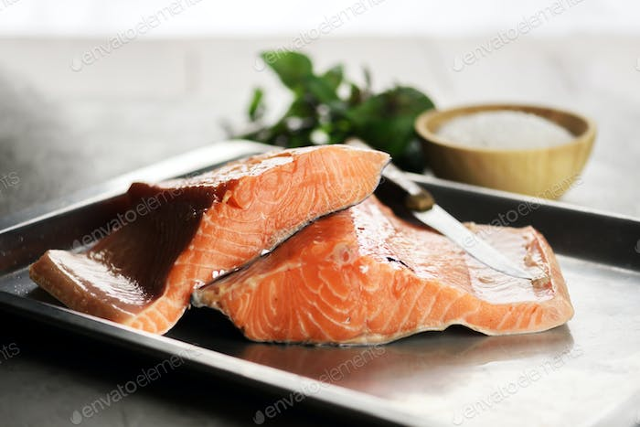 Fillet of salmon fish on metal plate closeup
