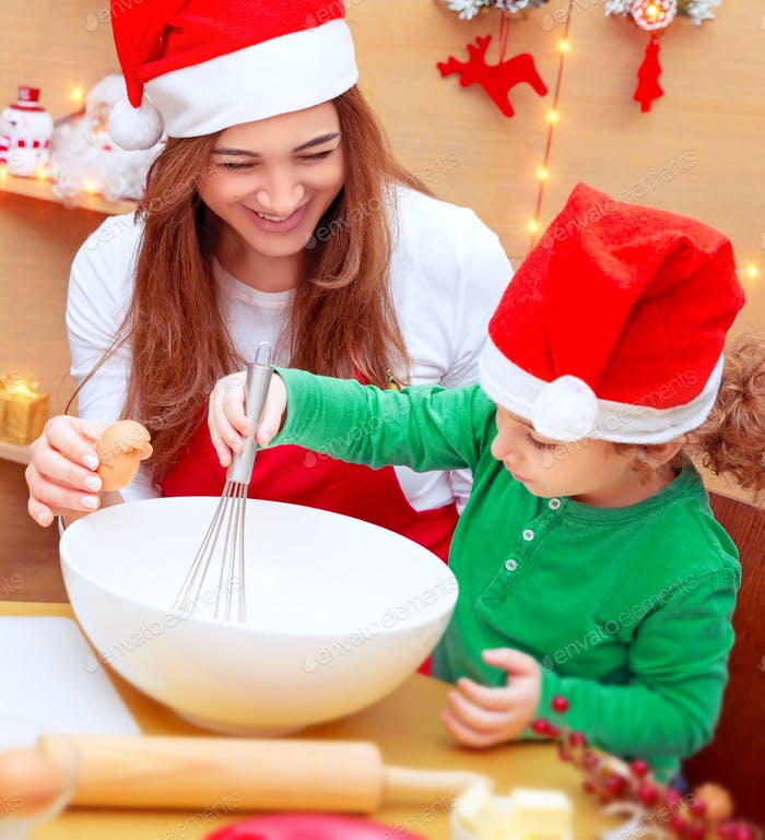 Mother with son baking Christmas cookies