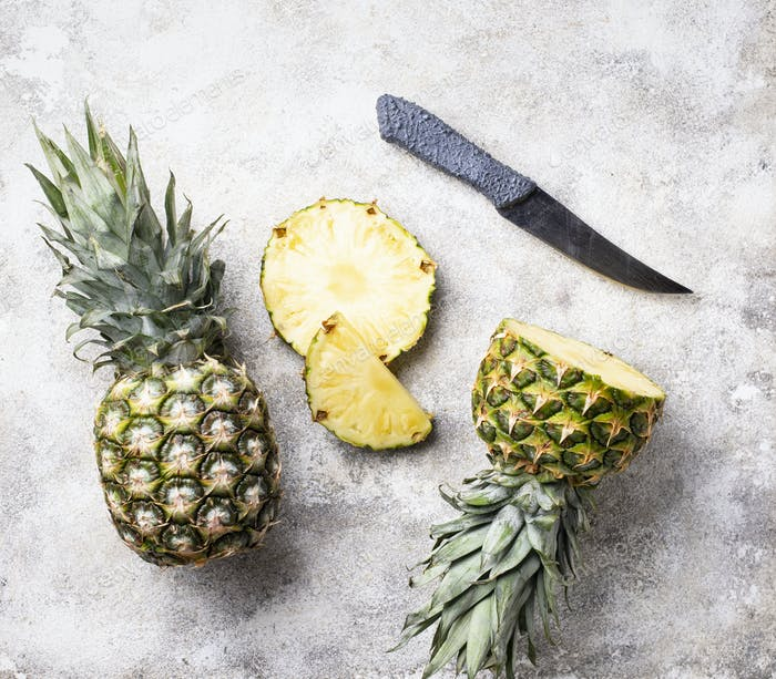 Sliced pineapple on white table