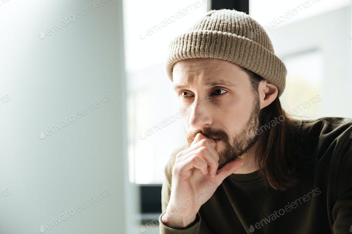 Young handsome man in office using computer
