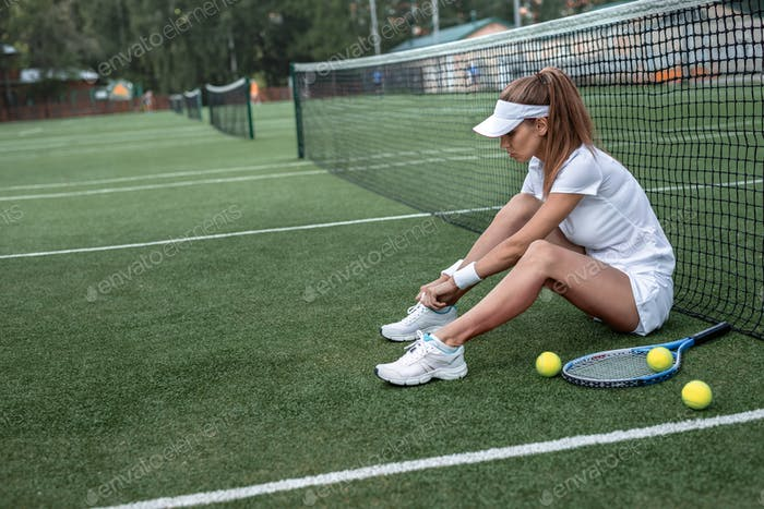 Attractive woman on the tennis court