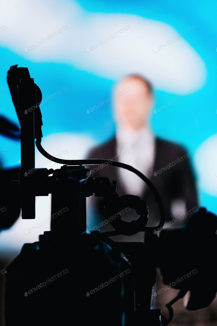 Camera Recording Presentation Of A Speaker
