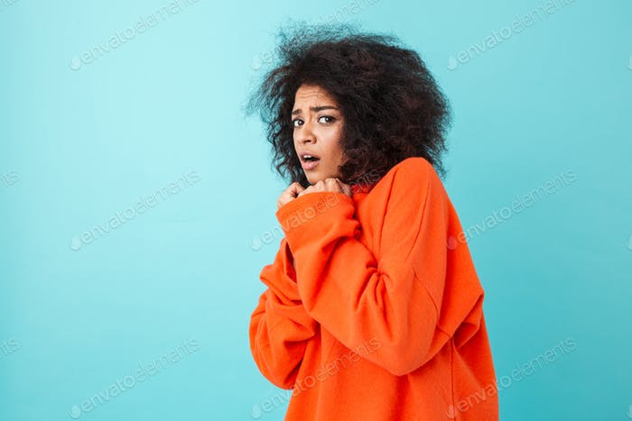 Colorful image closeup of scared woman in red shirt posing on ca