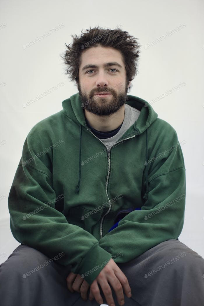Portrait of a caucasian man in jogging pants and a sweatshirt hoodie.