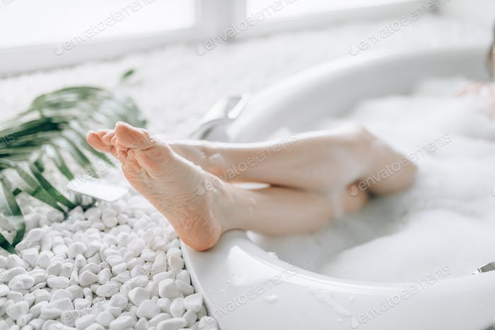 Female person heels sticking out of the bath