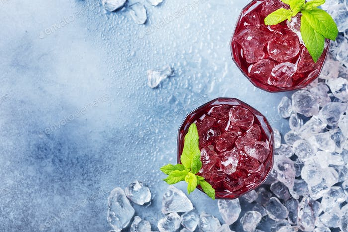 red coctail with ice and mint