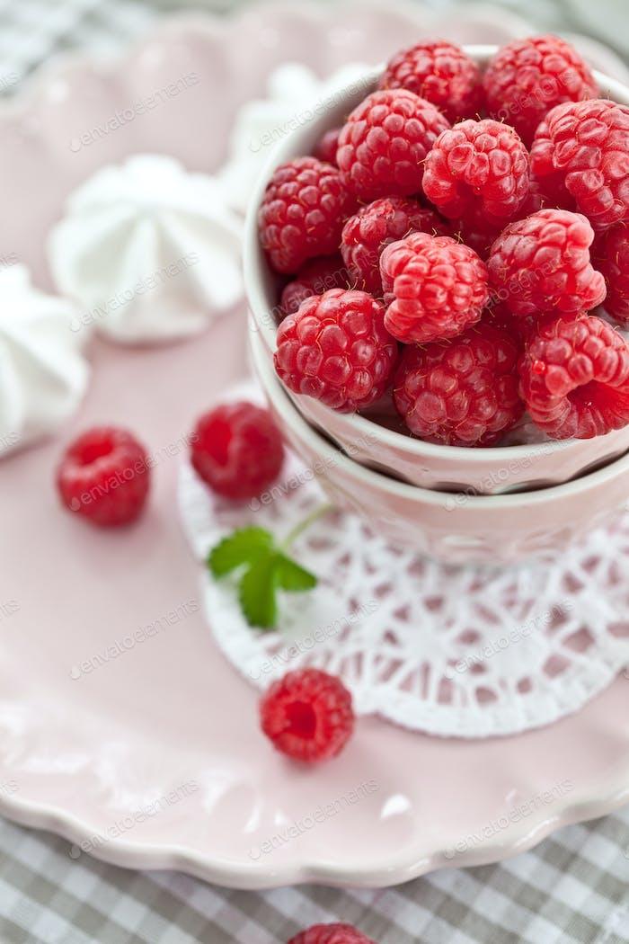 Fresh raspberries on a pink plate