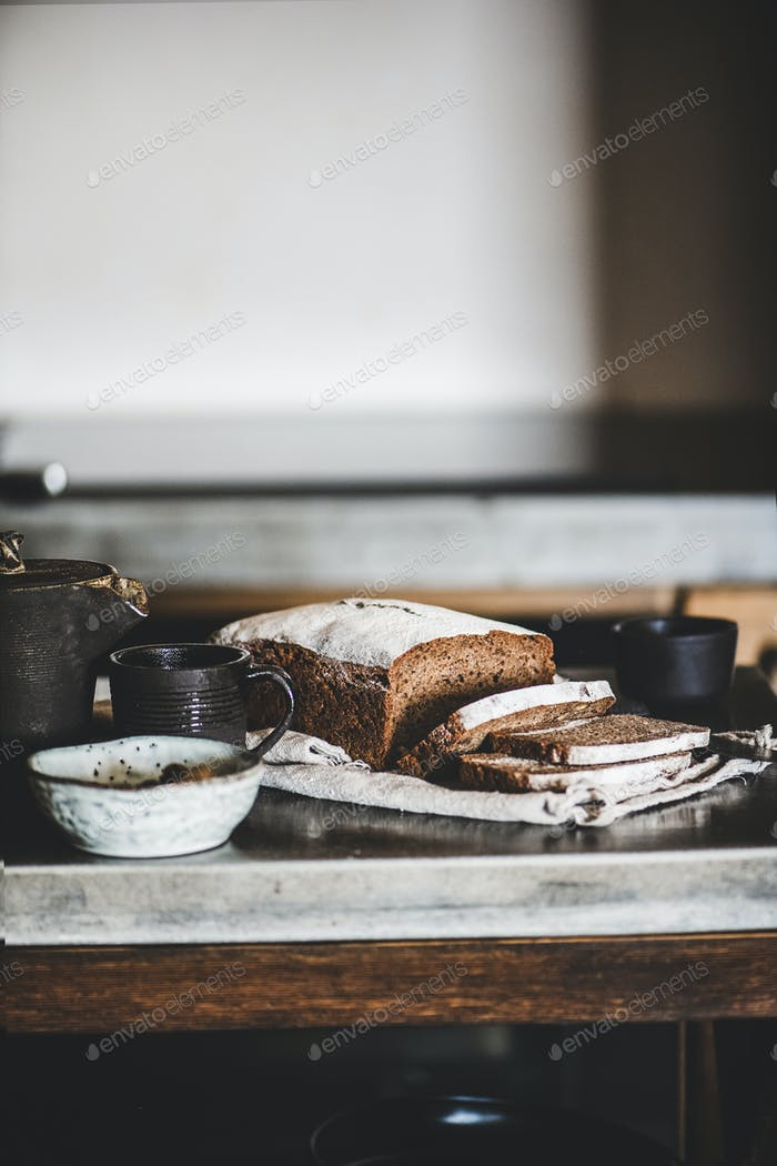 Healthy rye Swedish bread cut in slices on cotton towel