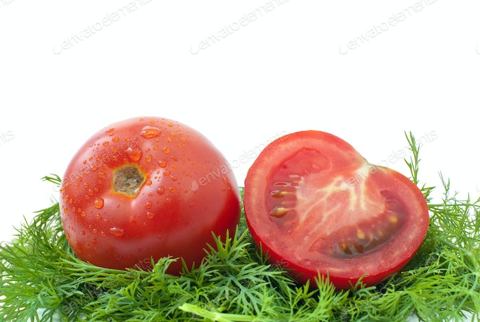 Ripe red tomato and half ower some dill