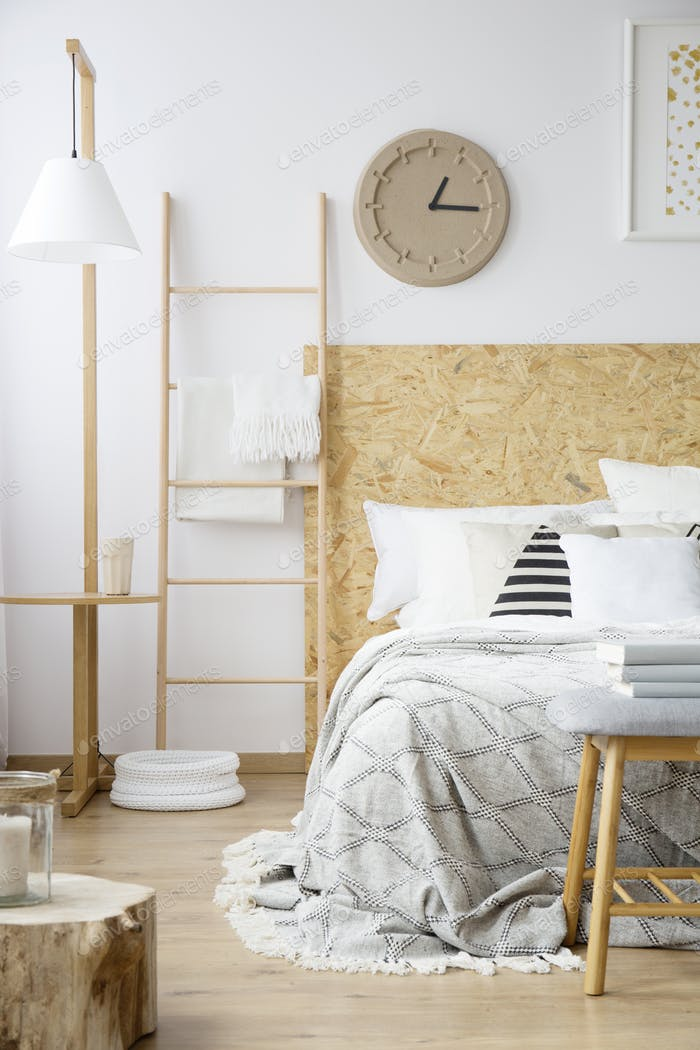 Natural bedroom with paper clock