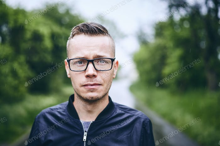 Man with eyeglasses in rain